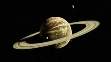 Saturno y su satélite natural